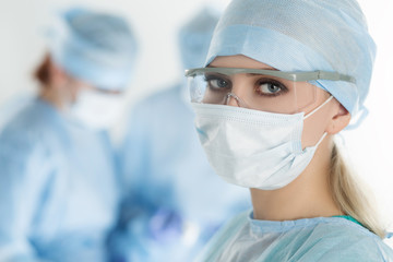 Close-up of surgeon woman looking at camera