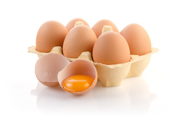 Eggs in the Package with one broken