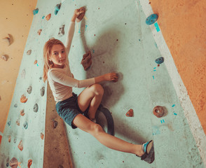 Free climber little girl training indoor