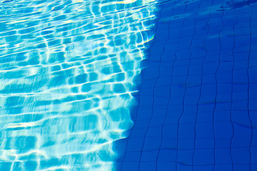 abstract of sun reflected in the water of the swimming pool : Bl