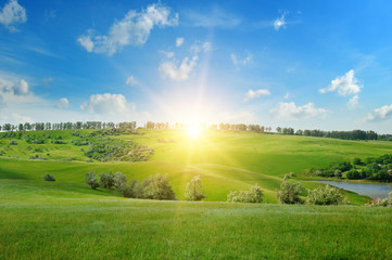 field, sunrise and blue sky