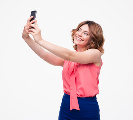Smiling woman making selfie photo