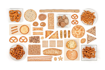 crackers and snacks on white background