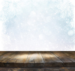 rustic wood table in front of glitter silver and white bright bokeh lights