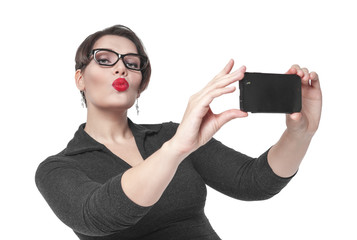 Beautiful plus size woman making picture of herself selfie isola