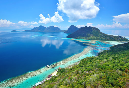 Aerial view of tropical island of Bohey Dulang near Siapdan Island, Sabah Borneo, Malaysia.