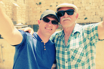 Selfie portrait of father and adult son near the Western Wall in