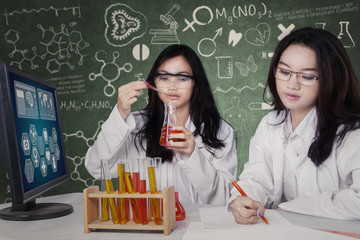 Two beautiful students working in lab