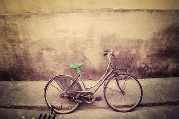old bicycle in a rustic street in Florence