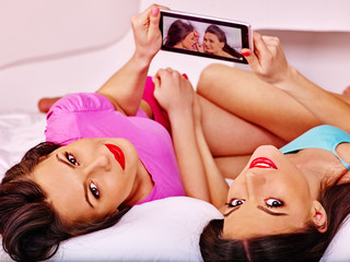 Lesbian women see pictures in bed.