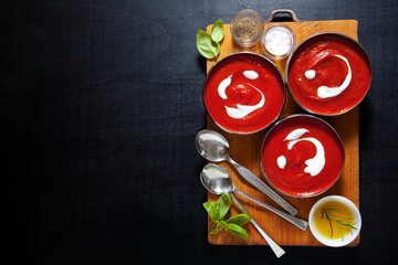healthy tomato soup with fresh basil leaves . salt & pepper. on