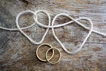 Double heart shaped rope and a double gold ring