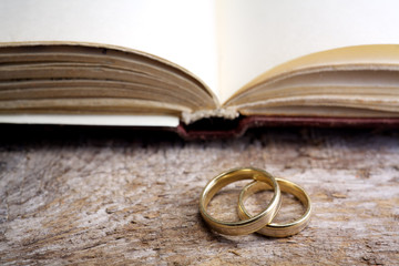 Two wedding rings with a bible