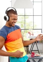 Young man enjoying music eyes closed