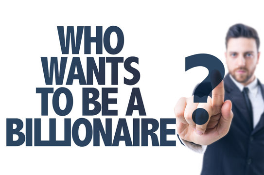 Business man pointing the text: Who Wants To Be a Billionaire?