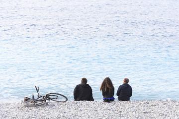 Friends on the beach of Nice, France