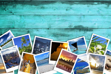 heap of travel photos on azure wood background
