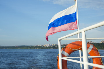 closeup of the flag on the stern of a recreational boat