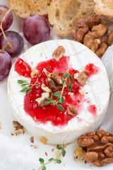 camembert with berry jam, vertical, top view