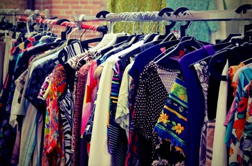 vintage clothes hanging at flea market