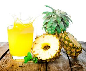 Pineapple with splash on wood