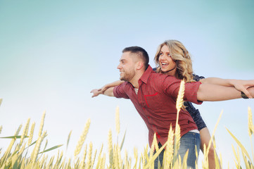 happy young couple in love have romance and fun at wheat field i