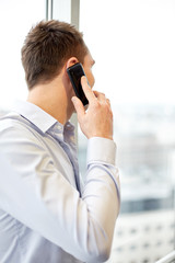 businessman calling on smartphone in office