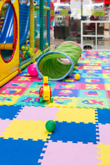 Childrens Play Toys on Bright Soft Tiles