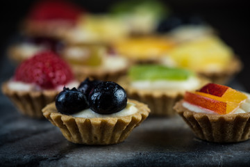 Mini pastry tartlets with fresh fruits