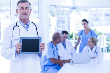 Doctor showing tablet pc during meeting