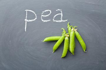 green peas on chalkboard