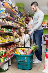 People purchasing food at supermarket