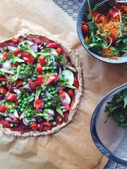 Pizza with a chickpea crust and salad
