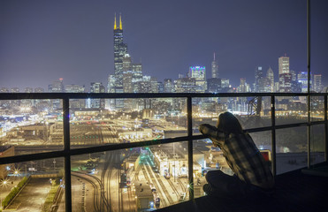 Man admiring a night view of Chicago skyscrapers, Illinois, USA