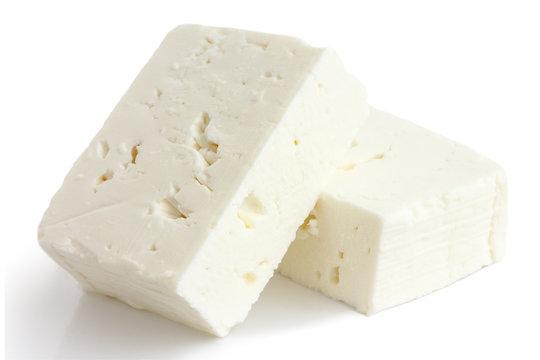 Greek feta cheese block isolated on white.