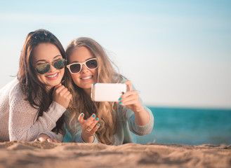 Two girls taking selfie