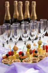 catering serving buffet with canape and champagne