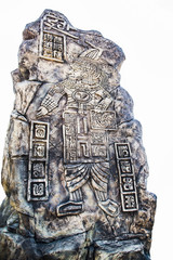 Ancient Mayan hieroglyphics in stone, from the ruins over white background