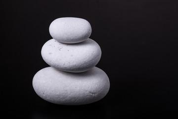 white pebbles on black