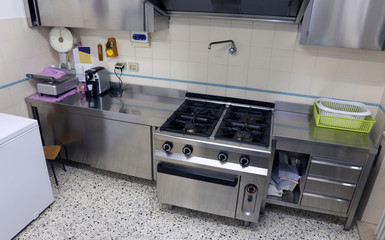 industrial kitchen with huge steel stove