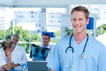 Handsome smiling doctor looking at camera