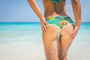 beautiful woman buttock on tropical beach