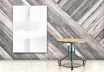 room with hanging blank crumpled white poster and wooden table a