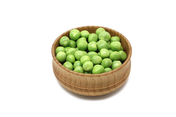 grain green peas in a wooden bowl on a white background