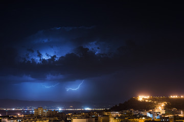 Storm cell over the city by night