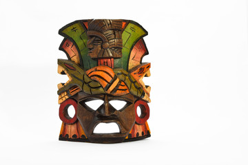 Indian Mayan Aztec wooden mask with anaconda and jaguar isolated on white background (full face presentation layout)