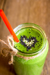 Green smoothie with heart of seeds