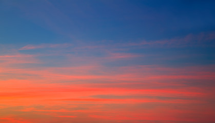 Sunset sky in red orange and blue background