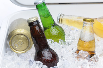 Assorted Beer Bottles and Cans in Cooler