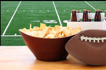 Chips, Deflated Football and Beer and TV Screen